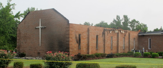 The Mount Zion AME Church in Greeleyville, S.C., is seen on Wednesday, July 1, 2015, after it was heavily damaged by fire. The church was the target of arson by the Ku Klux Klan two decades ago but a law enforcement source told The Associated Press that the most recent fire was not arson. (AP Photo/Bruce Smith)