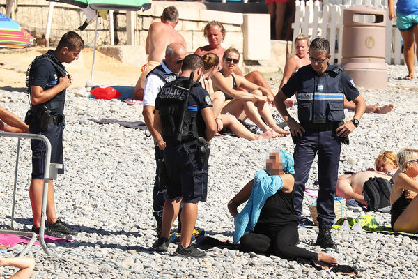 Exclusive... 52154073 Police fine the first person for wearing a burkini on the Promenade des Anglais beach in Nice, France on August 23, 2016. The cops made the woman remove her clothing in front of fellow beach goers following the recent burkini ban. **NO USE W/O PRIOR AGREEMENT - CALL FOR PRICING** FameFlynet, Inc - Beverly Hills, CA, USA - +1 (310) 505-9876 RESTRICTIONS APPLY: USA ONLY