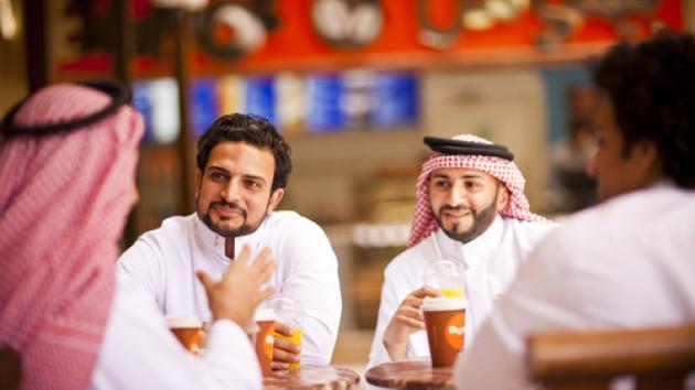 men_talking_in_a_group_saudi
