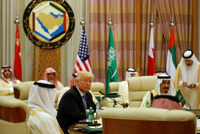 U.S. President Donald Trump sits down to a meeting with of Gulf Cooperation Council leaders, including Saudi Arabia's King Salman bin Abdulaziz Al Saud (R), during their summit in Riyadh, Saudi Arabia May 21, 2017. REUTERS/Jonathan Ernst - RTX36SZ3