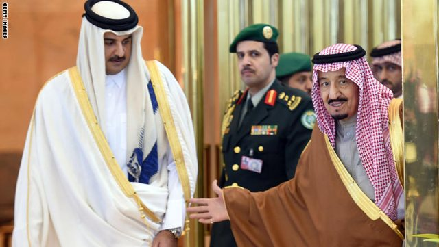 Saudi King Salman bin Abdulaziz (R) escorts Qatar's Emir Sheikh Tamim bin Hamad al-Thani upon the latters arrival to attend the 136th Gulf Cooperation Council (GCC) summit, in the Saudi capital Riyadh, on December 9, 2015. Gulf monarchs began arriving in Saudi Arabia for an annual summit, facing challenges including plunging oil revenues, the war in Yemen, pressure for peace in Syria and signs of regional divisions. AFP PHOTO / FAYEZ NURELDINE   / AFP / FAYEZ NURELDINE        (Photo credit should read FAYEZ NURELDINE/AFP/Getty Images)