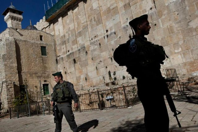 Israeli-police-stand-guard-on-a-site-known-to-Jews-as-the-Tomb-of-the-Patriarchs-and-to-Muslims-as-the-Ibrahimi-Mosque-in-Hebron